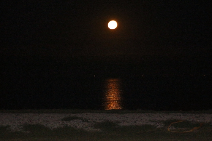 The moon over the water.